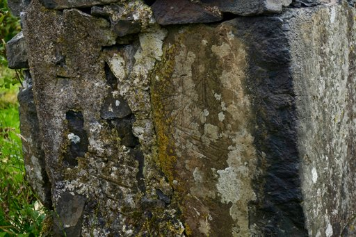 Carving of a ship on a ruined cottage on the grounds of Glengorm Castle